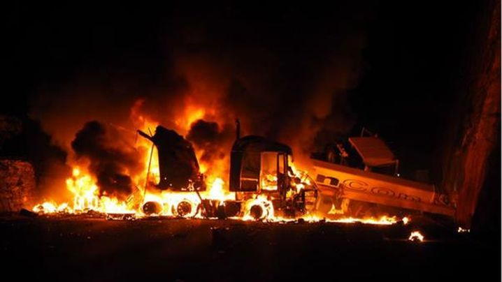 Truck Bursts into Flames after collision with Mobile Crane
